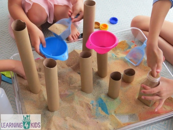 Sensory play with sand and cardboard tubes