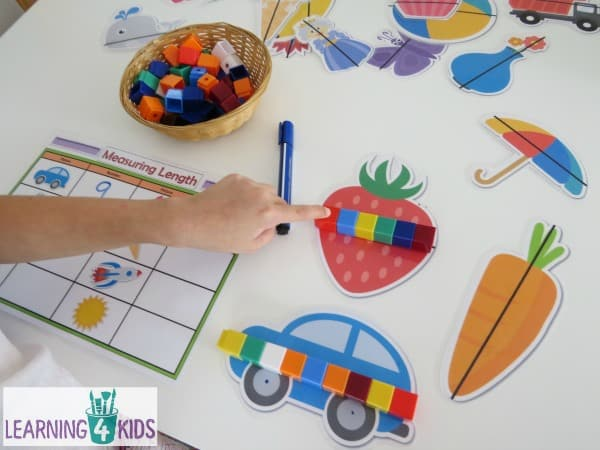 Printable Measuring Length Activity Mats - measure along the line on each picture and record the answer on the mat